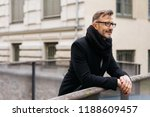 man in a winter scarf and... | Shutterstock . vector #1188609457