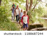family hiking along path by... | Shutterstock . vector #1188687244