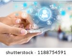 holding touchscreen device | Shutterstock . vector #1188754591