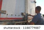 driver opens the doors on... | Shutterstock . vector #1188779887