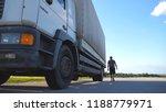 driver opens the door and exits ... | Shutterstock . vector #1188779971