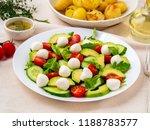 fresh salad with tomatoes... | Shutterstock . vector #1188783577