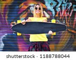 cool skateboard woman at a... | Shutterstock . vector #1188788044