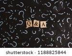 wooden alphabet tiles with q a... | Shutterstock . vector #1188825844