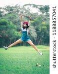 a beautiful woman posing jump... | Shutterstock . vector #1188857041
