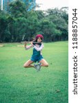 a beautiful woman posing jump... | Shutterstock . vector #1188857044