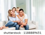 young family at home smiling at ... | Shutterstock . vector #1188889651