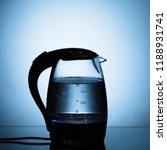 electric glass kettle on blue... | Shutterstock . vector #1188931741
