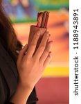 asian woman hand holding... | Shutterstock . vector #1188943891