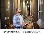 handsome man winemaker in a...   Shutterstock . vector #1188979174