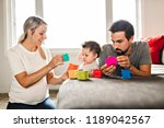 happy father  mother and little ... | Shutterstock . vector #1189042567