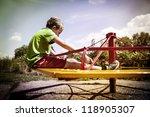 sad boy on a merry go round   Shutterstock . vector #118905307