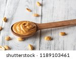 wooden spoon of peanut butter | Shutterstock . vector #1189103461