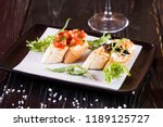 bruschetta with black caviar... | Shutterstock . vector #1189125727