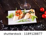 bruschetta with black caviar... | Shutterstock . vector #1189128877