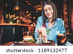 young woman sitting in a cafe... | Shutterstock . vector #1189132477