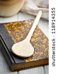 the old recipe book on wooden table - stock photo