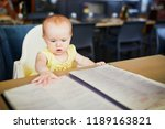 little girl in restaurant. baby ...   Shutterstock . vector #1189163821