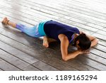 young latin woman doing yoga... | Shutterstock . vector #1189165294