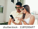 happy casual couple checking... | Shutterstock . vector #1189200697