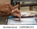 the artisans are using hammers... | Shutterstock . vector #1189286191