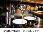 two espresso pouring from... | Shutterstock . vector #1189377544