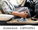 female hand using a car... | Shutterstock . vector #1189410961