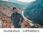 young man on beautiful view... | Shutterstock . vector #1189460611