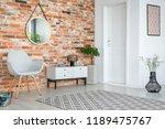 grey armchair and cupboard in...   Shutterstock . vector #1189475767