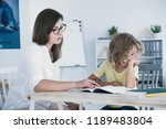 naughty boy doing homework with ... | Shutterstock . vector #1189483804