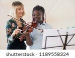 tutor teaching high school... | Shutterstock . vector #1189558324