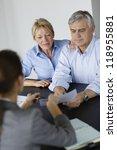 senior couple signing financial ... | Shutterstock . vector #118955881