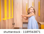 smiling adorable kid opening... | Shutterstock . vector #1189563871