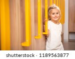 cheerful adorable kid standing... | Shutterstock . vector #1189563877