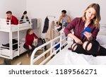 happy young woman traveler... | Shutterstock . vector #1189566271