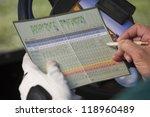 Golfer Marking Score On...