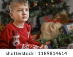 little boy with christmas gifts | Shutterstock . vector #1189814614