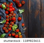 cherry tomatoes and basil  on a ...   Shutterstock . vector #1189823611