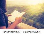 closeup woman hand hold the...   Shutterstock . vector #1189840654