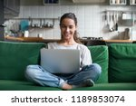 happy smiling woman sitting on... | Shutterstock . vector #1189853074
