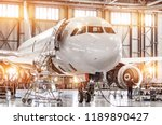 Stock photo passenger commercial airplane on maintenance of engine turbo jet and fuselage repair in airport 1189890427