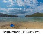 greek beach with blue swim fins | Shutterstock . vector #1189892194
