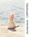 adorable baby girl on the beach ... | Shutterstock . vector #1189934581