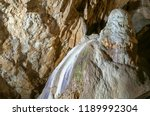 dark cave view from inside with ... | Shutterstock . vector #1189992304