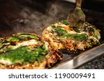 chef use spatula to cut the... | Shutterstock . vector #1190009491