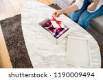 the box on the table  inside... | Shutterstock . vector #1190009494