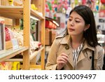 young traveler choosing... | Shutterstock . vector #1190009497