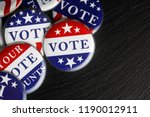 Small photo of Red, white, and blue vote buttons background