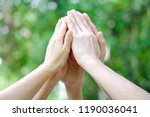 Small photo of five hand up of people working assemble corporate meeting show symbol Join forces teamwork quality and effective personnel Concept organizational development in teamwork and business