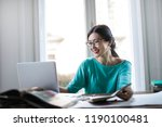 young asian woman working on a... | Shutterstock . vector #1190100481
